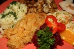 Polonez schnitzel topped with fried mushrooms and served with potatoes and a bouquet of salads $16.25
