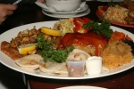 Polish combination plates - platter for 2 2 cabbage rolls, 6 pierogi, polonez schnitzel and salad bouquet $33.00