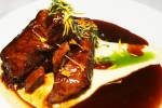 LAB Restaurant Short ribs braised in chinotto with polenta, and gremolata