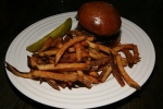 Bestellen burger, caramelized onions, raclette, house-made brioche & frites $18