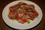 Beef Carpaccio lemon, herb oil, piave cheese $10