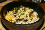 BIBIMBAP - Rice, mushrooms & cheese bibimbap with seaweed sauce in sizzling stone bowl`