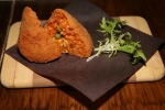 Arancini - Authentic rice cones, stuffed with chicken and veal ragù, green peas, and fresh Scamorza $8