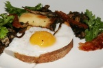 Duck Egg with Mushrooms (Yellowfoots, Hen of the Woods, King Oyster) Toast, Mustard Greens, Bacon