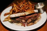 Organic Montreal-Style Brisket $13 on sourdough with house-made dill pickle & frites. Montreal rub slow roasted