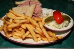 Lean corned beef platter on double rye with french fries cole slaw old dill and sweet pepper