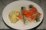 "Lightly Smoked Herring ""A L'Huile"" Warm Dijon Potatoes 18,00"