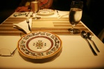 The plateware: hand-painted Italian plates deliberately mismatched