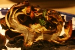 Carciofi Alle Brace (roasted artichokes exteriors blackened from exposure to wood embers Interiors soft yielding)