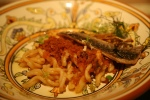 Gemelli con le Sarde (twinned pasta twists black currants pine nuts golden pieces of fried sardine)