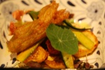 Ribbons of raw zucchini fried zucchini blossoms saffron-tomato-chili vinaigrette (side to pork shoulder)