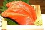 Sashimi with soy sauce tasting