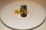 Lacquered Iberian pork, its crackling and a citrus salad and lemon