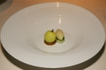 Apple in a clear soup with apple false and bay leaf ice cream