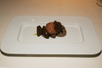 Liquid chocolate fritter served with pieces of chocolate