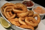 CALAMARI Deep-fried calamari rings, served with tomato salsa $8.00
