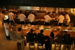 Count the cooks in Momofuku Noodle Bar as see from the balcony