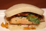"Crispy Suckling Pig ~ Czech steamed bun ""'peach ~ basil ~ $6"