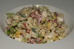 Sidecar Salad Chopped jicama, corn, red onion, cucumber, tomato, radish, feta with creamy oregano dressing