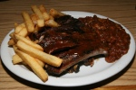 Ribs – One pound Tender side ribs, finished with sauce or with the sauce served on the side $23.50 Plates (includes two of coleslaw, potato salad, fries or BBQ Beans)
