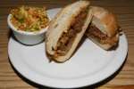 Pulled Pork The classic BBQ sandwich $7.95 Sandwiches (Includes one of coleslaw, potato salad or fries)