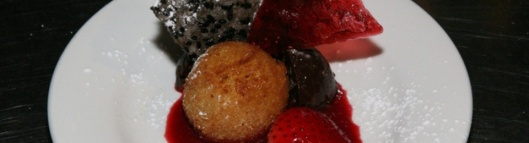 White Chocolate Arancini with Puffed Rice Rocher and Raspberry Butter Sauce