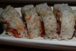 27. Dragon Roll shrimp tempura unagi avocado topped with tobikko sweet barbecue sauce 10 pieces $11 .75