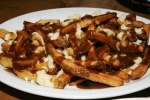 Poutine with cheese curds and gravy $6.50 (with Smoked Meat $9.50). This is not a very southern dish, actually nothing about poutine is southern. Try the Beef Brisket poutine, there is nothing else like it.