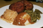 SZNYCLE (SCHNITZELS) $6.75 2 round pieces of ground pork, rolled in bread crumbs and pan fried, Includes cup of soup, mashed potatoes, green beans and warm sauerkraut.
