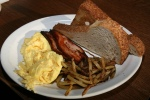 eggs-3, schmaltz hash, toast, bacon or sausage or pork chop (+4) $13