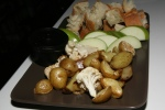 Fondue, Canadian Swiss, Pinot Grigio, Roasted Garlic, Nutmeg served with Roasted potatoes, cauliflower, baguette, apples, Bumbercrop beer onions