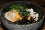 Stone Bowl Seafood Sea Urchin Don 13.80 sautéed prawn, squid, scallop & salmon roe on rice with sea urchin & ginger sauce, served in sizzling hot stone bowl