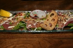 Maguro Carpaccio Thinly sliced Albacore Tuna Carpaccio Avocado, Daikon, Onions, Garlic Chips. $11.80
