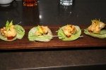 empura lobster tail nuggets, lemon aioli, cocktail sauce on iceberg lettuce circles
