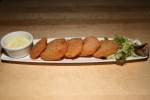 Breaded Tomato Fritter 7 Fresh tomato slices deep fried with garlic powder. Mustard mayo sauce on side