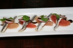 white marinated anchovies, grapefruit, radish, black garlic 9