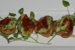 Roasted brussels sprouts purée on crostini with crisp pancetta Canadian maple