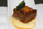 Braised beef short ribs with mascarpone polenta, pepper caponata and natural jus