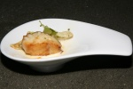 Pan seared miso glazed cod with water chestnut pot sticker, baby bok choy and citrus butter
