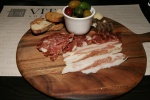 House-made salumi board with Parmigiano Reggiano and marinated olives $16.95