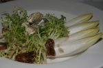 Salade d'Ambert Frisé, endive dried figs & blue cheese from the Avergne, with a walnut vinaigrette $8,50