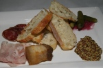 Assiette De Charcuteries $15Duck & chicken liver parfait; Duck & pork pâté à l'orange; Pressed smoked pork hock; Pork rillons Niagara cured pork loin; Niagara prosciutto; Niagara saucisson sec