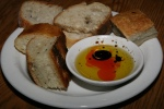 Selection of house breads, olive oil, balsamic vinegar and chili sauce