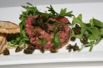 Steak tartare with fried capers, grainy mustard and fresh country toast