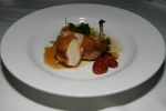 Roasted chicken supreme with zucchini noodles, oven cured tomatoes, crisp spinach and natural jus