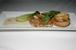 Pan seared halibut with tempura onion rings, bok choy and miso sauce