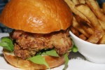 "buttermilk-fried chicken ""club"" - arugula, maple bacon, lemon aioli, pommes frites"