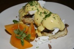 Smoked Brisket Benedict - biscuit, poached egg, tomato 12