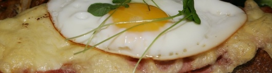 Croque Madame - black forest ham with emmenthal cheese béchamel sauce and a fried egg $12