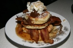 Apple pancakes with maple syrup glazed apples walnut crumble cinnamon cream bacon $15